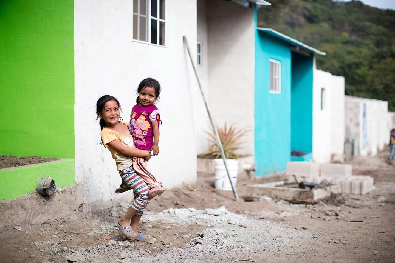 A family celebrates their new home in El Salvador.