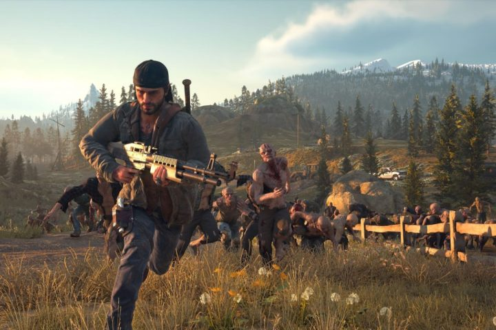 A horde of Freakers chases Deacon St. John in Days Gone.