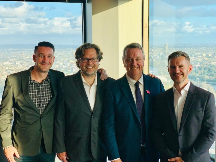 From left to right: Sledgehammer communications director Brian Miggels, studio head Aaron Halon, Minister of Creative Industries Martin Foley, and Andy Wilson.