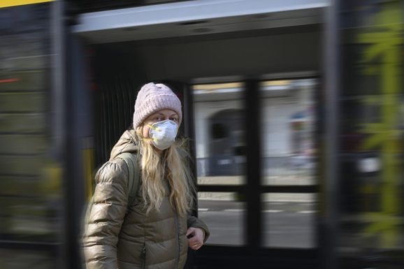 Woman with protective mask on the street