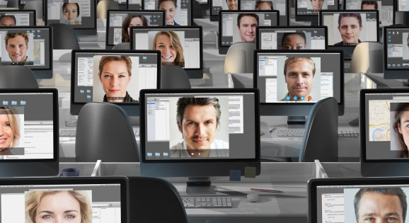 Many computers with peoples faces on each screen