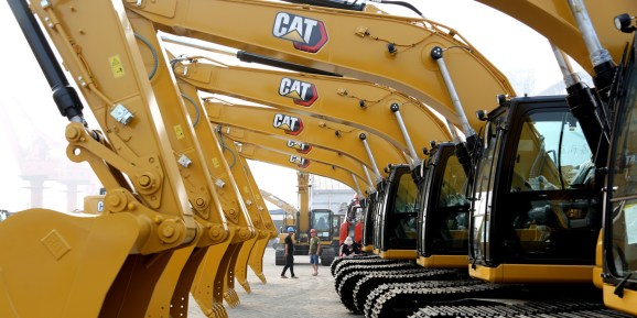 Construction machines of Caterpillar Inc. stand ready for shipment at Lianyungang port on June 15, 2020 in Lianyungang, Jiangsu Province of China.