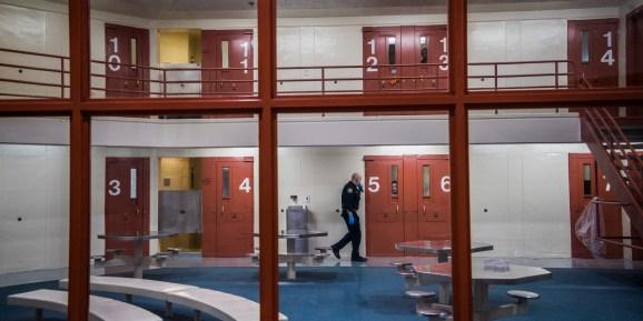 An officer checks on prisoners at Santa Rita Jail on Thursday, April 5, 2018, in Dublin, Calif.