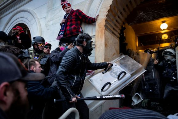 WASHINGTON, DC - JANUARY 6: Trump supporters clash with police and security forces as people try to storm the US Capitol on January 6, 2021 in Washington, DC. (photo by Brent Stirton/Getty Images)