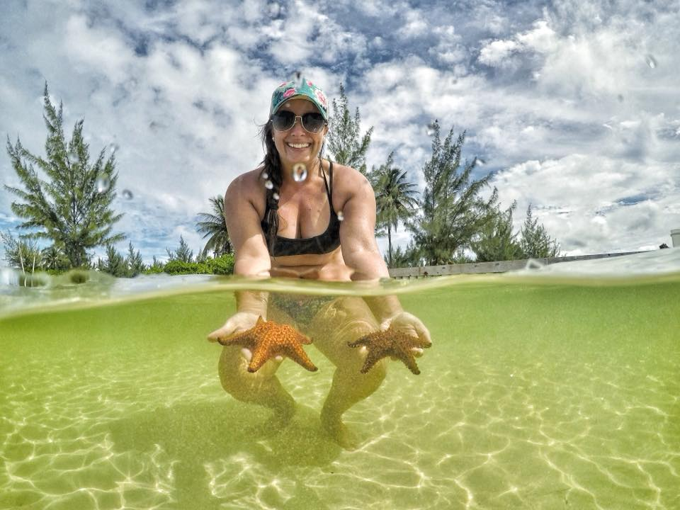 Holding A Pair Of Sea Stars In The Cayman Islands