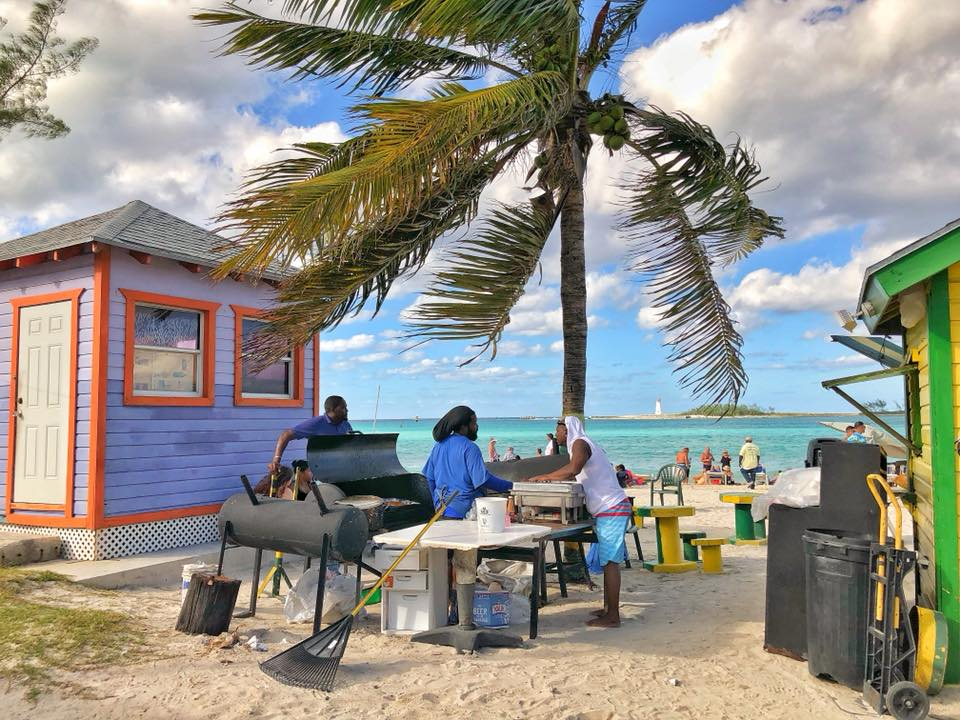 Locals cooking on the beach in Nassau Bahamas
