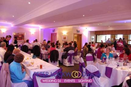 smokies oldham during the wedding breakfast with purple up lighting