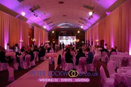 Tenants-Hall-in-Tatton-Park-with-pinkish-purple-uplighting-and-stage-lighting