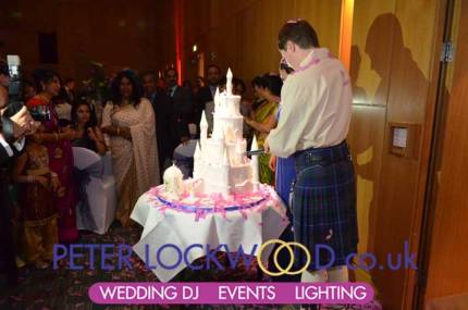 after-the-confetti-as-fluttered-down-the-bride-and-groom-are-still-cutting-the-cake