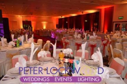 red and gold asian wedding lighting in blackpool de vere village hotel