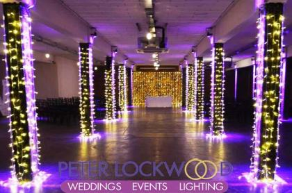 wedding fairy lit aisle in the bays at victoria warehouse