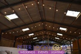 festoon lighting in a wedding barn