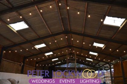 festoon lighting in a wedding barn