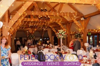 warm-white-oak-beam-lighting-at-sandhole-oak-barn