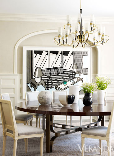 Pop Art Decor Contemporary Home White Dining Room with Chandelier and Graphic Wall Art