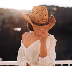 woman with hat and white shirt