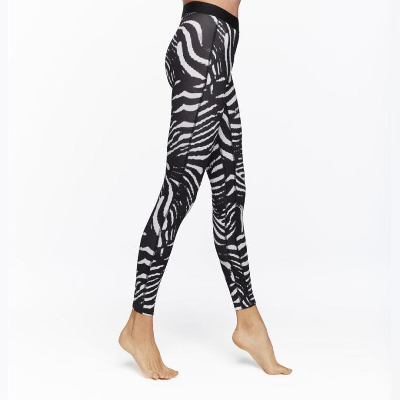 Girl wearing a VYAYAMA - DUSK PRINT LEGGING just the image of the two girl legs