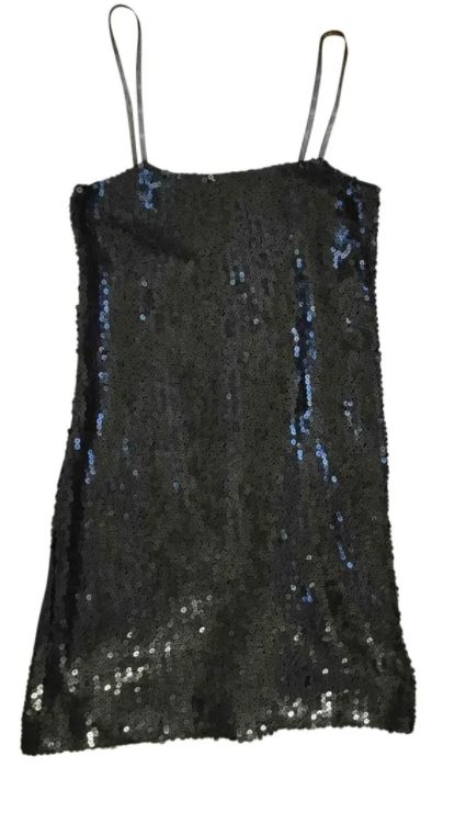 Chanel Glitter Mini Dress to find at Vestiaire Collective or to discover more at veragallardo.com site