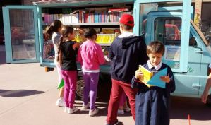 children visiting the traveling mobile library