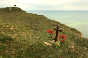 Crosses dot the cliff edge at Beachy Head, England, where many people have committed suicide