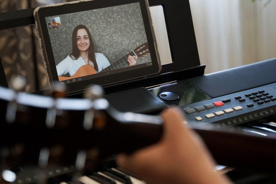 Female musicians rehearsing online