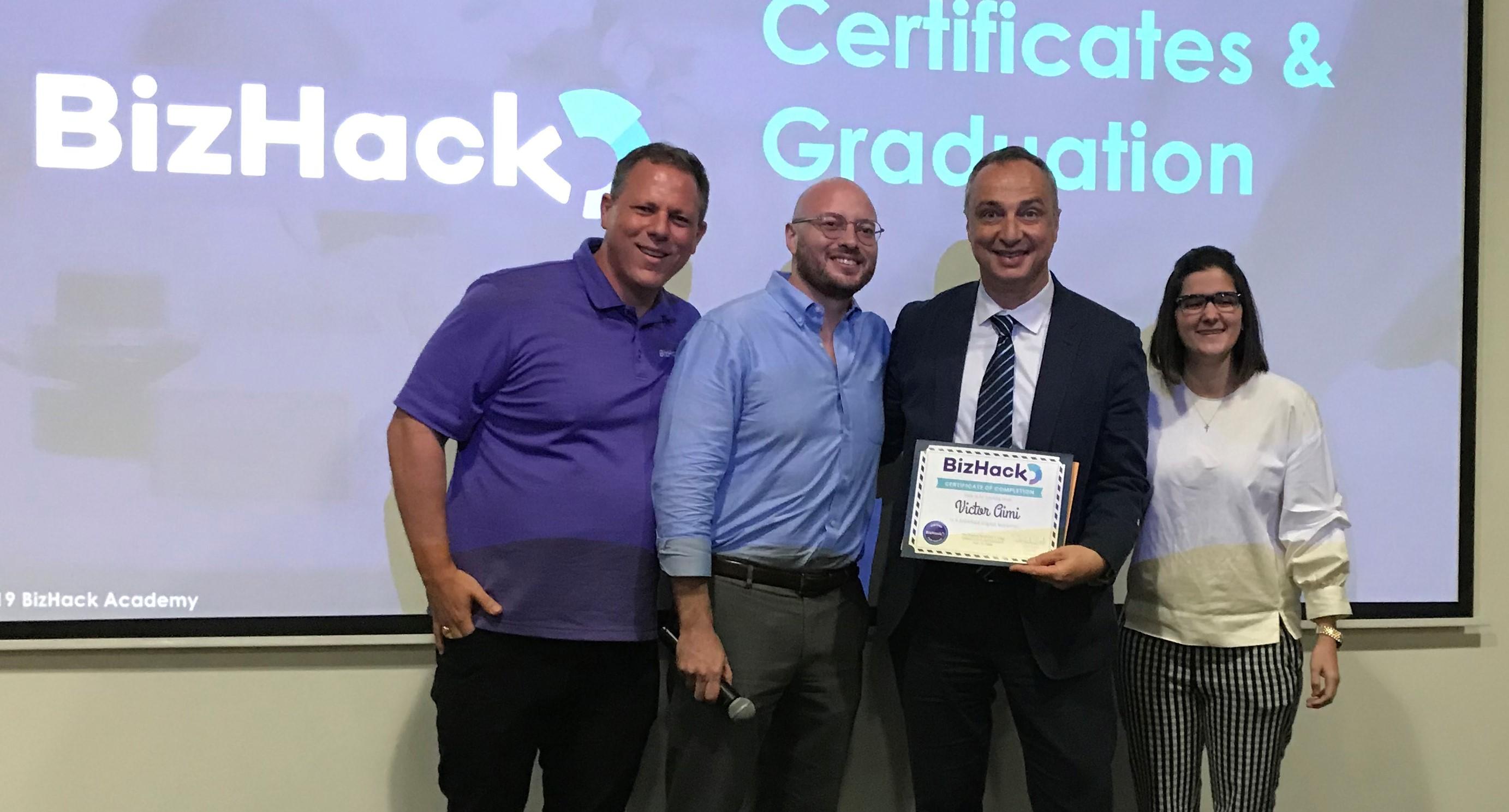 Dan Grech of BizHack at a class graduation in 2019