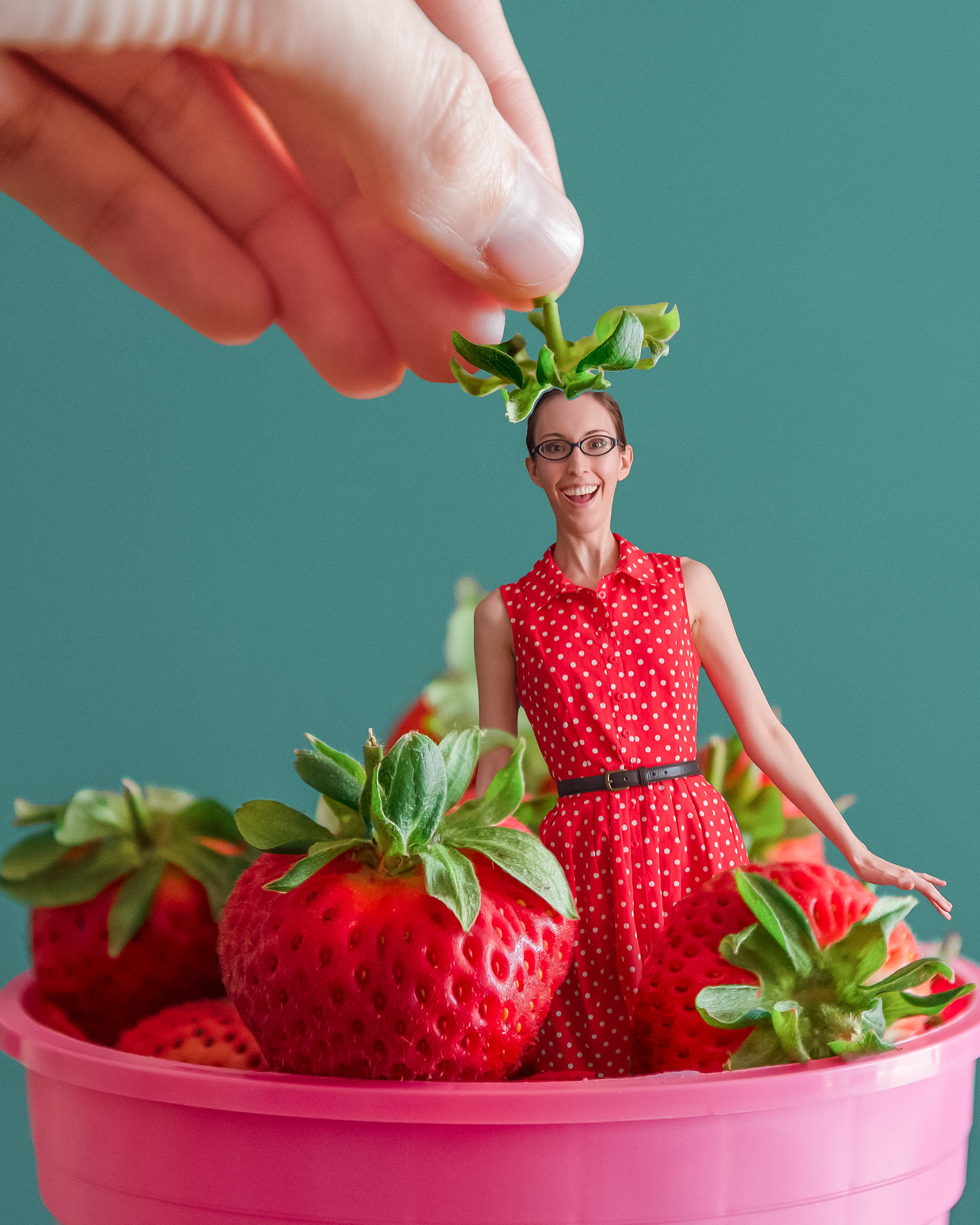 Portrait of Ellie photoshopped as a strawberry