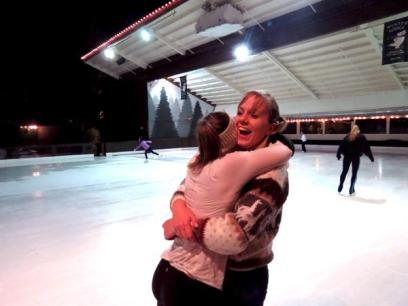 Junior Maya-Ben Efraim and Senior Angela Pomeroy laugh and embrace upon seeing each other at the rink for Sunday night practice.