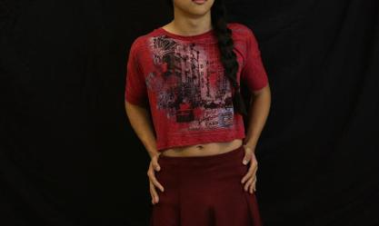 """Girl clothes"": A model shows off their ""girl clothes.""  Many genderqueer people struggle with wanting to wear gendered clothing."