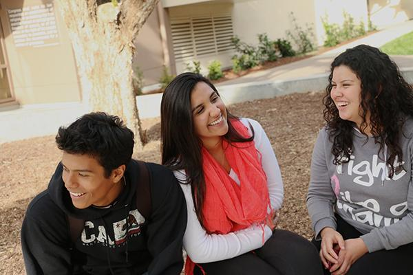 Seniors Lennyn Castillo and Clarissa Valencia relax during a passing period along with Valencia's cousin, junior Cristal Valencia. They are all first generation college students at Paly.