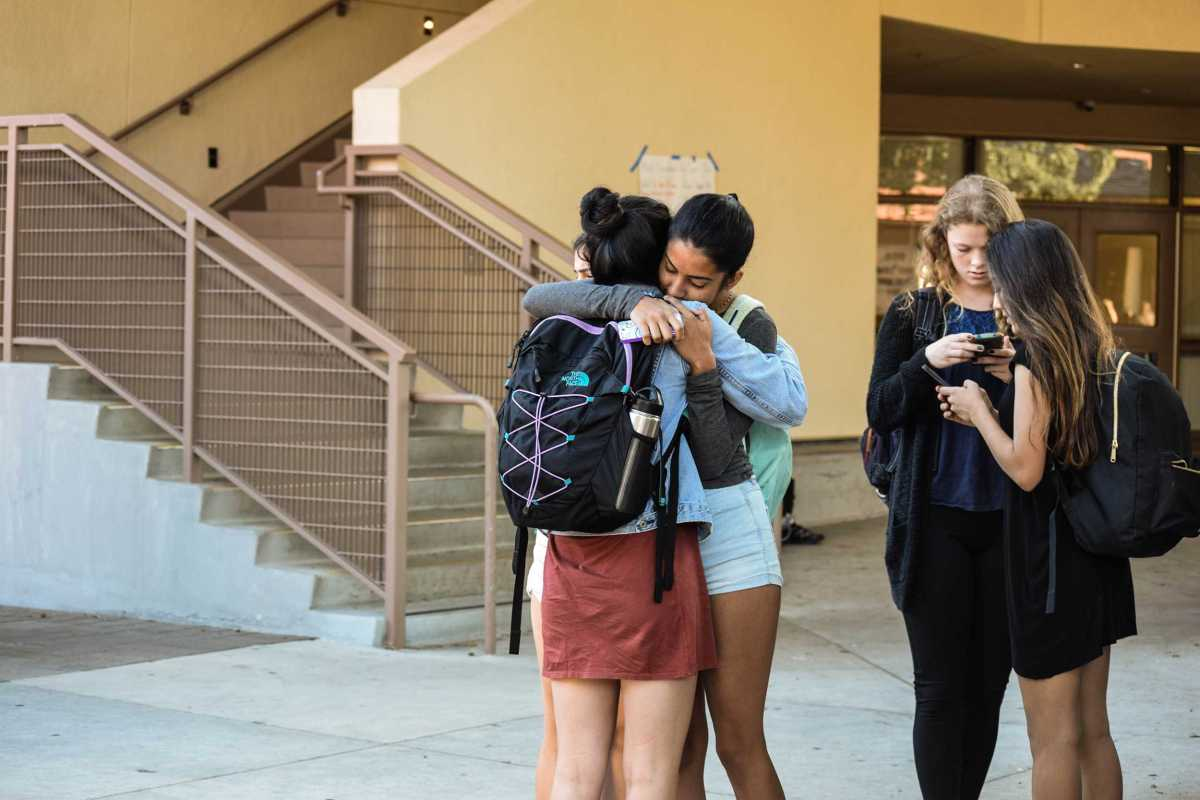 Sophomores Anoushka Sharma and Jenny Tseng comfort one another about the results of the election during brunch.
