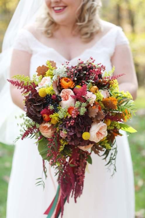 Image of bride holding flowers from Julie James Floral Design