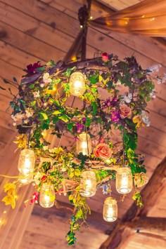 Colourful magical wedding drapes chiffon fairy lights butterflies barn festival wedding bright colourful floral chandelier lighting verdigris wedding design decoration styling event design
