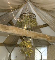 Winter woodland wedding inspiration lanterns branches leaves fairy lights taupe chiffon drapes glass baubles Verdigris Event design Wick Farm Bath Party Decorations Props 2