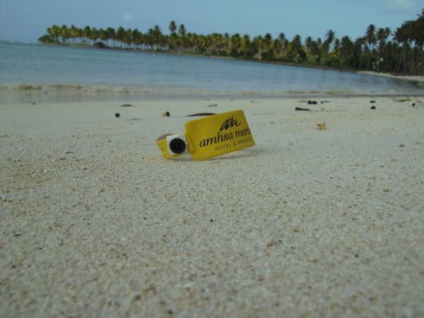 My yellow AI wristband chilling on the beach