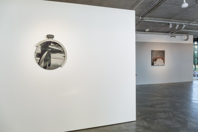 (left) Deb Mansfield, Niigata/Vladivostok Plummet. Photo-tapestry, concrete frame, burnt bronze bridle hook, 60mm x 670mm x 590mm. 2016. (right) Lena Nyadbi Untitled (2013) 90×90 cm Ochre and pigments on canvas. Image by Document Photography.