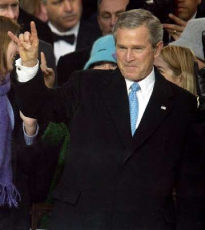 masonic hand signs: President George Bush flashing the devil's horn hand signal.