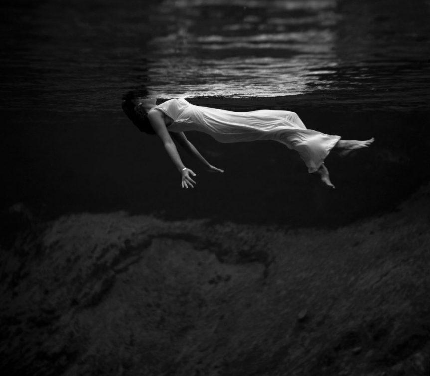 Image: woman floating in deep water