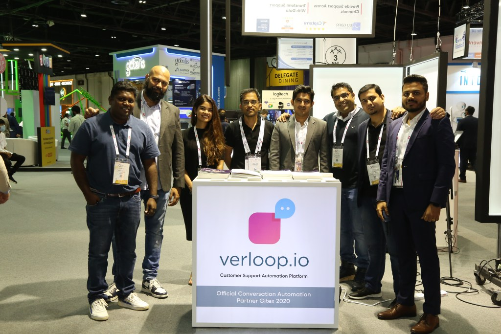 Members of Verloop.io team standing near the company stall