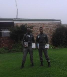 Bongani and Thulani show off their new bird books and binoculars