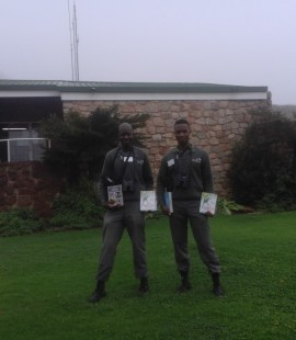 Bongani and Thulani show off their new bird books and binoculars