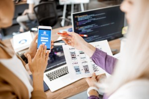 designers-developing-ideas-for-mobile-app