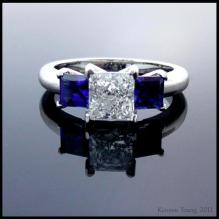 Diamond and sapphire princess cut three stone engagement ring in platinum