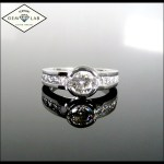 Diamond bezel and channel set engagement ring in platinum
