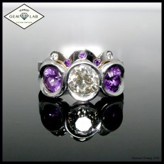 Diamond and purple sapphire engagement ring and wedding band set
