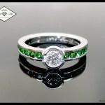 Diamond and green garnet engagement ring in platinum