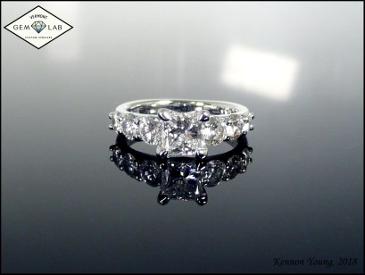 Princess and round cut diamond engagement ring in platinum