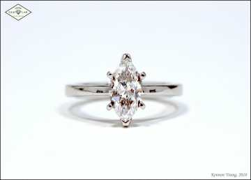 marquise solitaire engagement ring in platinum