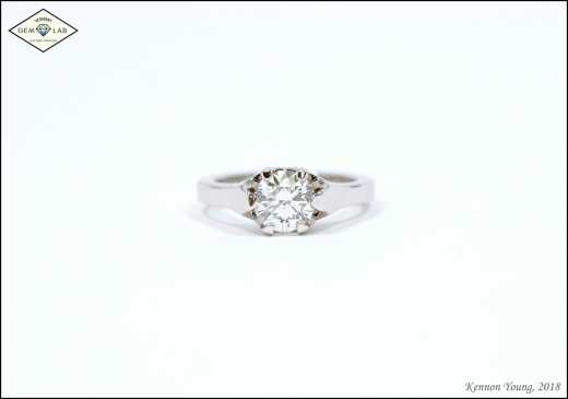 """Brooklyn"" themed diamond solitaire engagement ring in platinum"