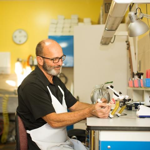 Eric Kjarsgaard, Dental Technician, in the Vernon Denture Clinic lab